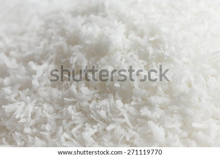 Abstract detail of dessicated coconut. Selective focus. - stock photo
