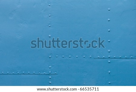 Abstract detailed blue metal wall background texture with seams and rivets - stock photo