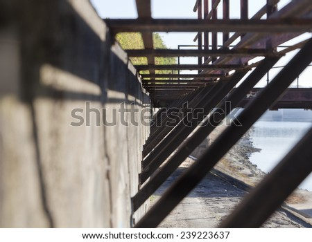 Abstract details of an abandoned dam, riverside