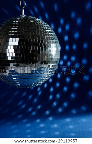 Abstract disco ball with light spots on dark blue background - stock photo