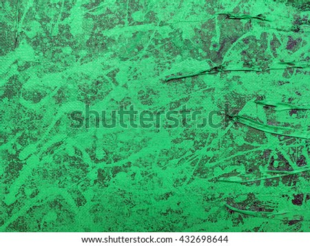 abstract dripping paints on green canvas background