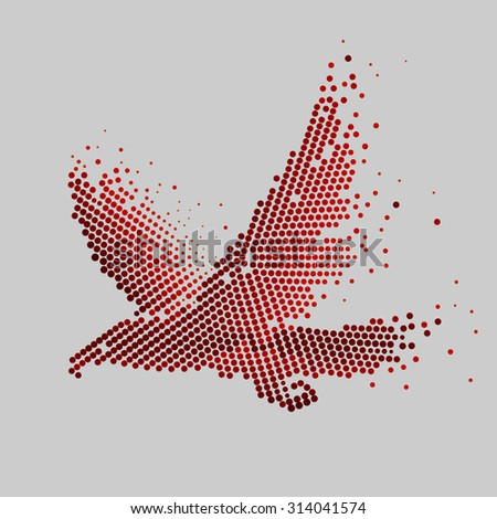 Abstract eagle of circles. abstract image of an eagle in flight in the technique of small circles, dots in red on a gray background. Profile of a flying eagle, hawk, vulture, a bird of prey. - stock photo