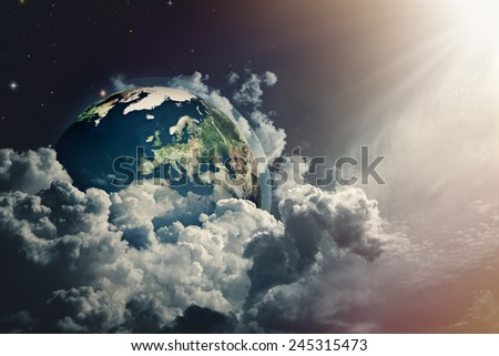 Abstract Earth view in the cloudy skies. NASA imagery used