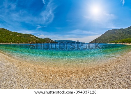 Abstract Empty Beach with clear transparent azure waters on a sunny day - stock photo