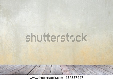 Abstract empty interior background with grungy concrete wall and wooden floor - can be used for montage or display your products