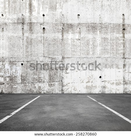 Abstract empty parking interior background with road marking and white concrete wall - stock photo