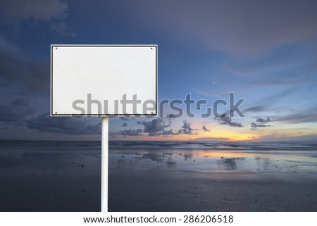 Abstract empty rectangular white sign over sun rise beach background - stock photo