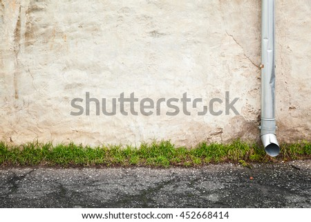 Abstract empty urban background, old house wall with downspout near asphalt road