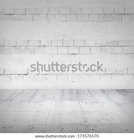 Abstract empty white interior with brick wall and concrete floor - stock photo