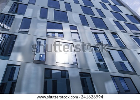Abstract facade lines and glass reflection on modern building.  - stock photo