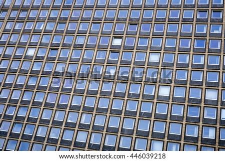 Abstract facade of a modern office building - stock photo