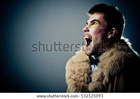 abstract fashion shot. color portrait of a young man