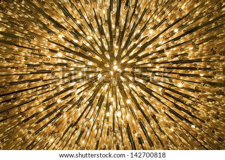 Abstract festive background - bright orange lights as stars