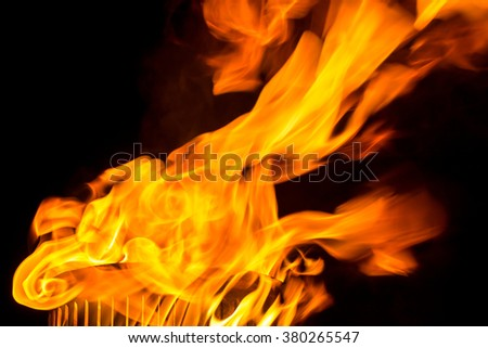 Abstract fire flames from torch, isolated on black background