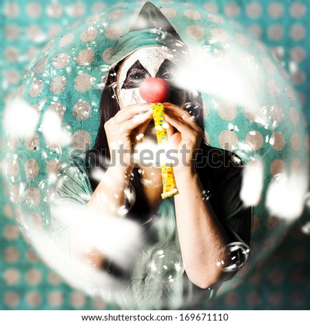Abstract fish-eye view of a medical clown blowing on a party horn in a haze of floating soap bubbles. Monster party - stock photo