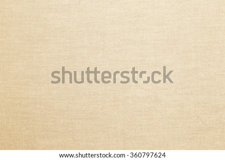 Abstract flat bright cream tan colored fabric textile texture background:detail of plain burlap backdrop:rustic seamless pattern canvas structure clothing concept:grey color of linen wallpaper picture - stock photo