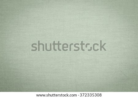 Abstract flat green olive color fabric textile texture background:detail of plain burlap backdrop:rustic seamless pattern canvas structure clothing concept:vintage color of linen wallpaper picture  - stock photo