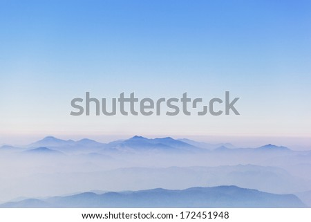 Abstract fog mist on top view of mountain - stock photo