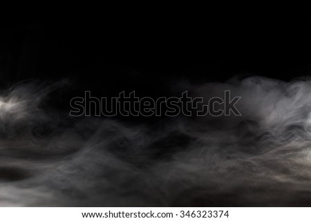 Abstract  fog or smoke move on black color background - stock photo