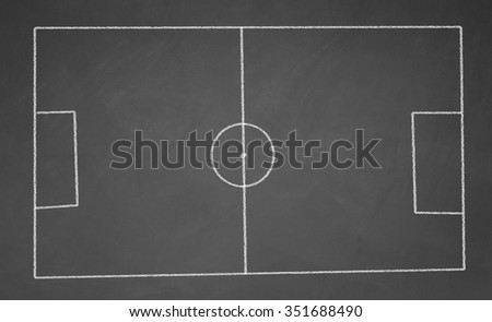 Abstract football field drawn with chalk on blackboard - stock photo