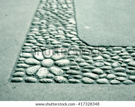 Abstract Foreground Toned Feature Flower Pebble Paving - stock photo