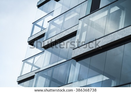 Abstract fragment of modern architecture, walls made of glass and concrete. Blue tonal filter photo effect - stock photo