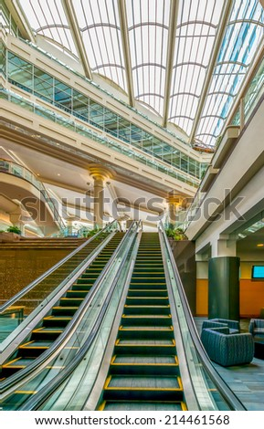 Abstract fragment of the architecture of modern lobby, hallway of the luxury hotel, shopping mall, business center with empty escalator stairs in Vancouver, Canada. Interior design. - stock photo
