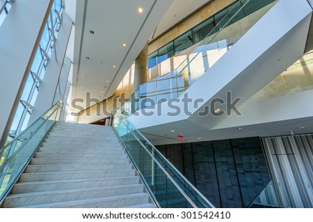 Abstract fragment of the architecture of modern lobby, hallway of the luxury hotel, shopping mall, business center in Vancouver, Canada. Interior design. - stock photo