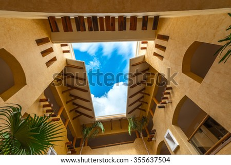 Abstract fragment of urban architecture of caribbean. tropical style building, hotel. - stock photo