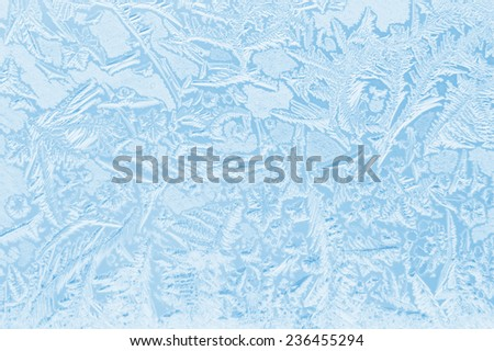 Abstract frosty pattern on glass. - stock photo