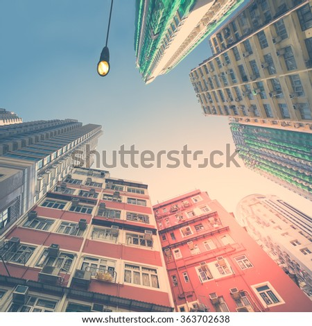 Abstract futuristic cityscape view with modern apartment building skyscrapers. Hong Kong - stock photo