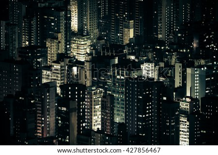 Abstract futuristic night cityscape with illuminated skyscrapers. Hong Kong aerial view panorama