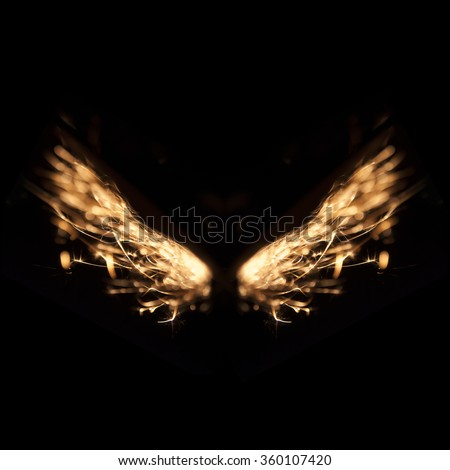Abstract Glowing Flow of sparks resemble wing on black background  - stock photo