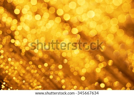 abstract gold bubble lights , Bokeh Christmas background with circle designs or blurred stars shining, glitter magic background