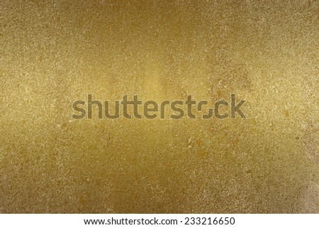 abstract gold in color ,shine satin ,nacre background  with  grunge background texture  wallpaper for brochure or website background, elegant luxury gold elements for web and digital design  - stock photo
