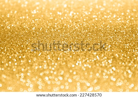 Abstract gold sparkle glitter background - stock photo