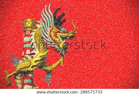 Abstract golden dragon on red background