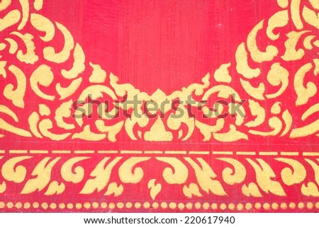 abstract golden pattern on red wall. - stock photo