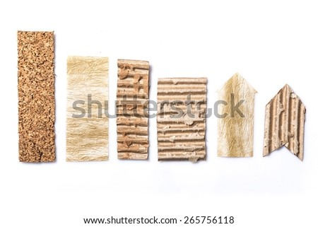 Abstract. Graphic columns set with wood, cork, carton isolated on a white background. Useful for infographics about ecology - stock photo