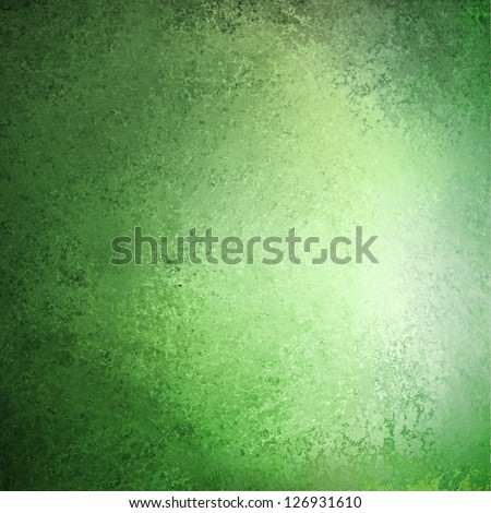 abstract green background pastel Easter color or spring color of mint green, faint vintage grunge background texture gradient design, bright whiter center spot, old green paper faded darker edges - stock photo