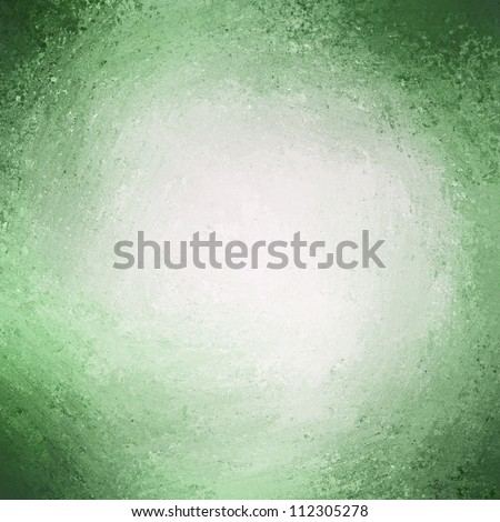 abstract green background with white center spotlight for text with rough vintage texture on border or frame on green pastel paper for Christmas background - stock photo