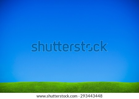 abstract green grass on blue sky  - stock photo