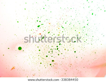 Abstract green (red, yellow) spots on a red-white background. - stock photo