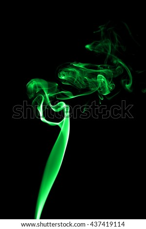 Abstract green smoke on black background from the incense sticks