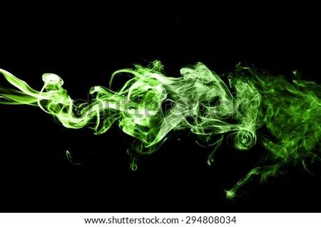 Abstract green smoke on black background, smoke background,green ink background,green, beautiful color smoke - stock photo