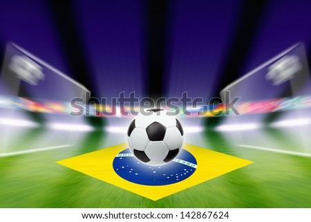 Abstract green soccer stadium, soccer ball, bright spotlights, soccer goals, Brazil flag - stock photo