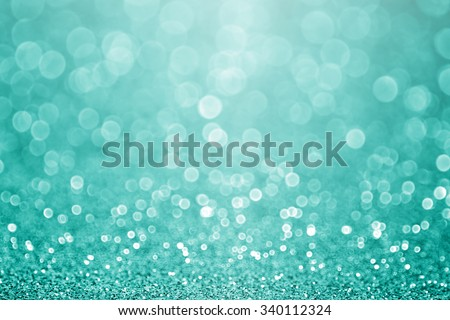 Abstract green teal or turquoise glitter sparkle background or aqua Christmas party invitation - stock photo