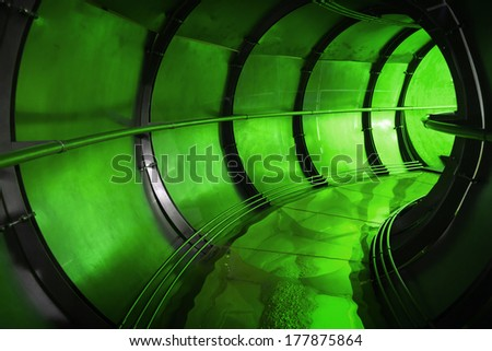 Abstract green underground industrial sewerage tunnel interior  - stock photo
