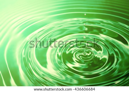 Abstract green water drops and circle ripple. - stock photo