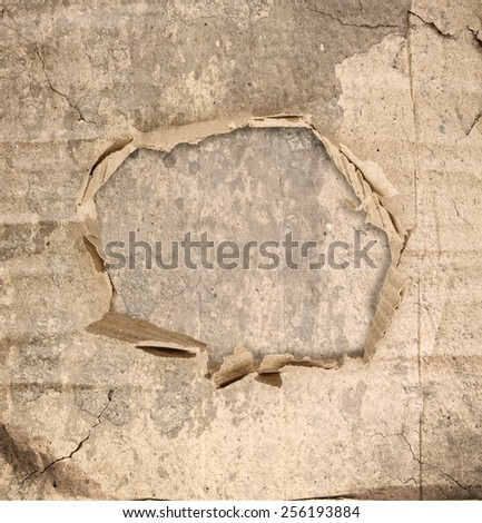 Abstract grunge wall background with paper hole in the middle - stock photo